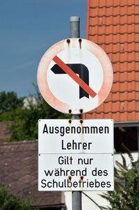 No left turn sign - except teachers.jpg